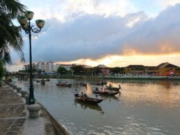 Image of boats on the water at sunset in Hoi An, Vietnam