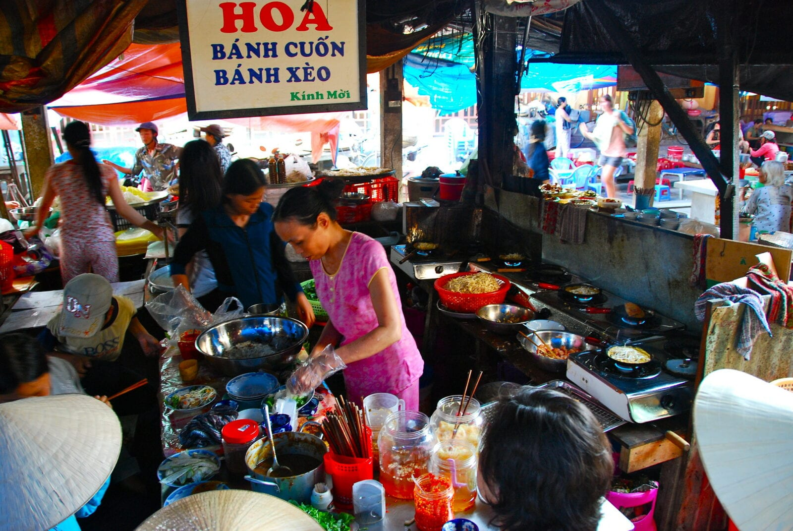 Image of a woman cooking food in Hoi An, Vietnam