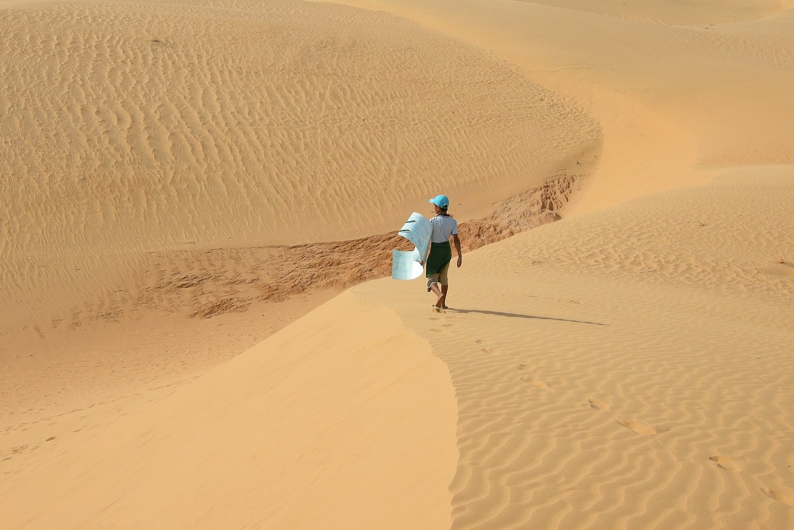 Image of a person at the sand dunes in Mui Ne, Vietnam.