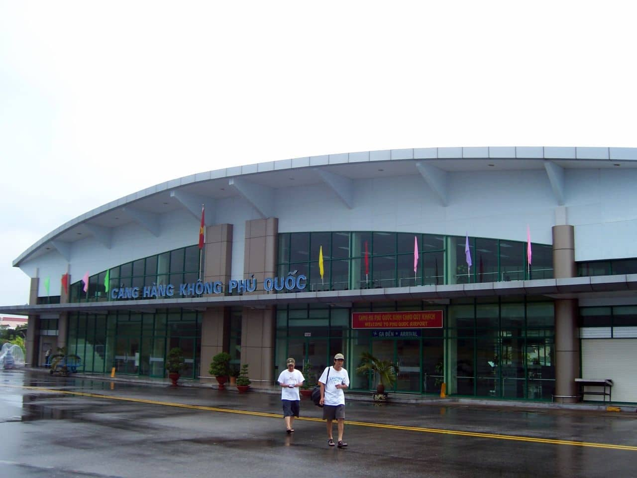 Image of two men walking out of the Phu Quoc International Airport in Vietnam