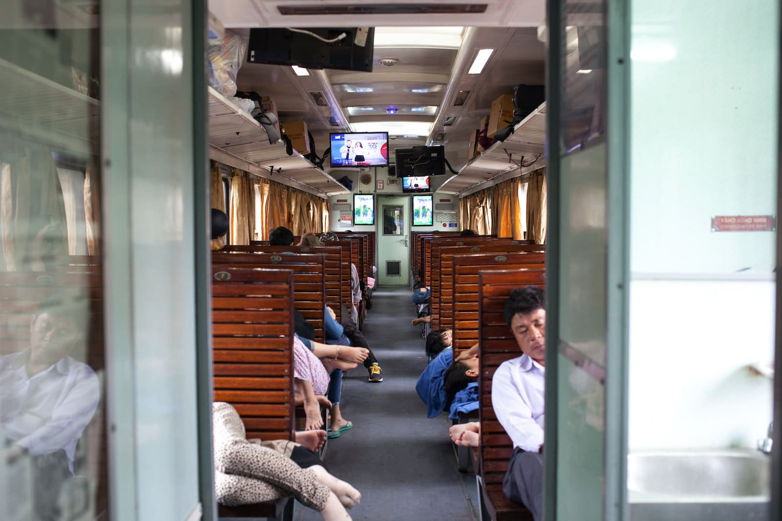 Image of people sleeping on the Reunification Express in Vietnam