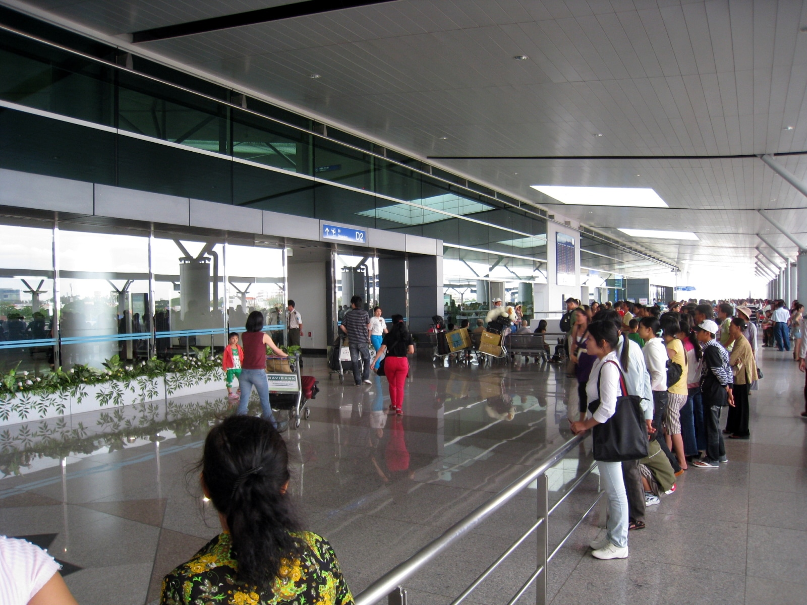 Image of flyers at the entrance of the Tan Son Nhat International Airport in Vietnam