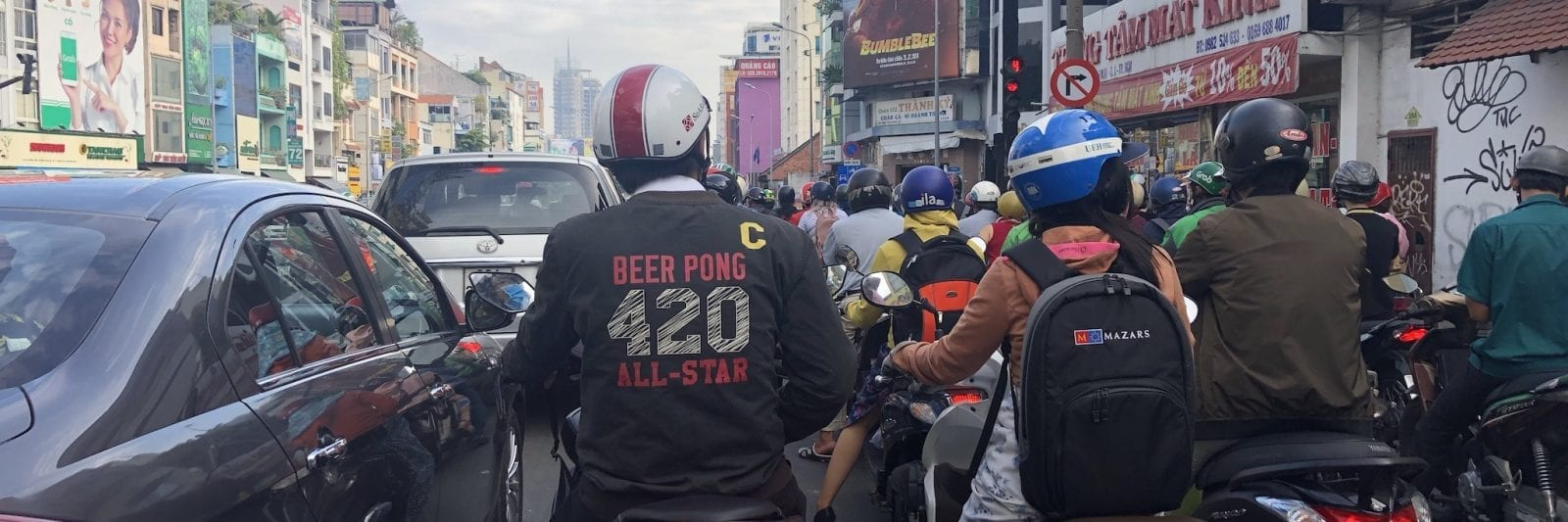 Driving a Motorbike in Saigon Vietnam 420 Beer Pong Champion