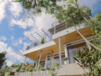 Image of the exterior of the Nhà của Người và Ta homestay in Dalat, Vietnam