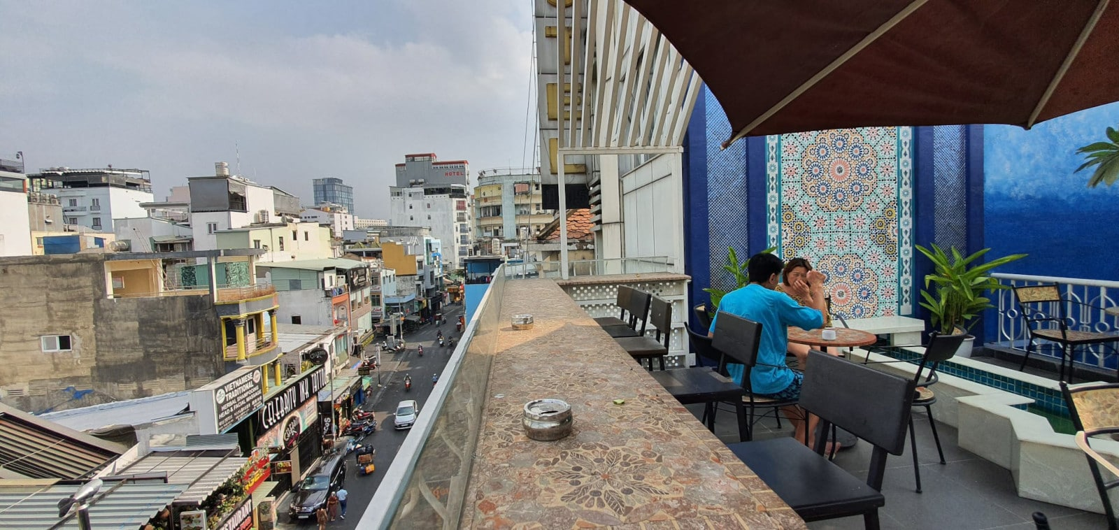 Image of people on the balcony at Aquarizon Boutique Hostel in HCMC, Vietnam