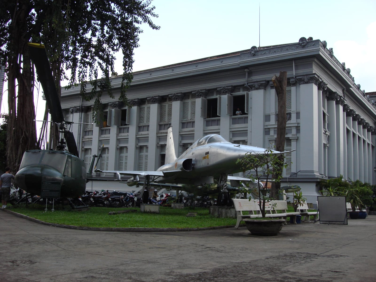 Image of a helicopter and military plane at the Ho Chi Minh Museum in Saigon