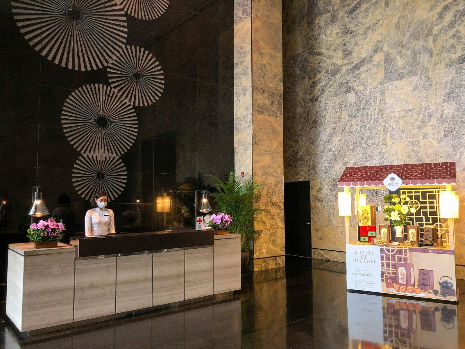 Image of the reception desk at the Lotte Hotel Hanoi in Vietnam