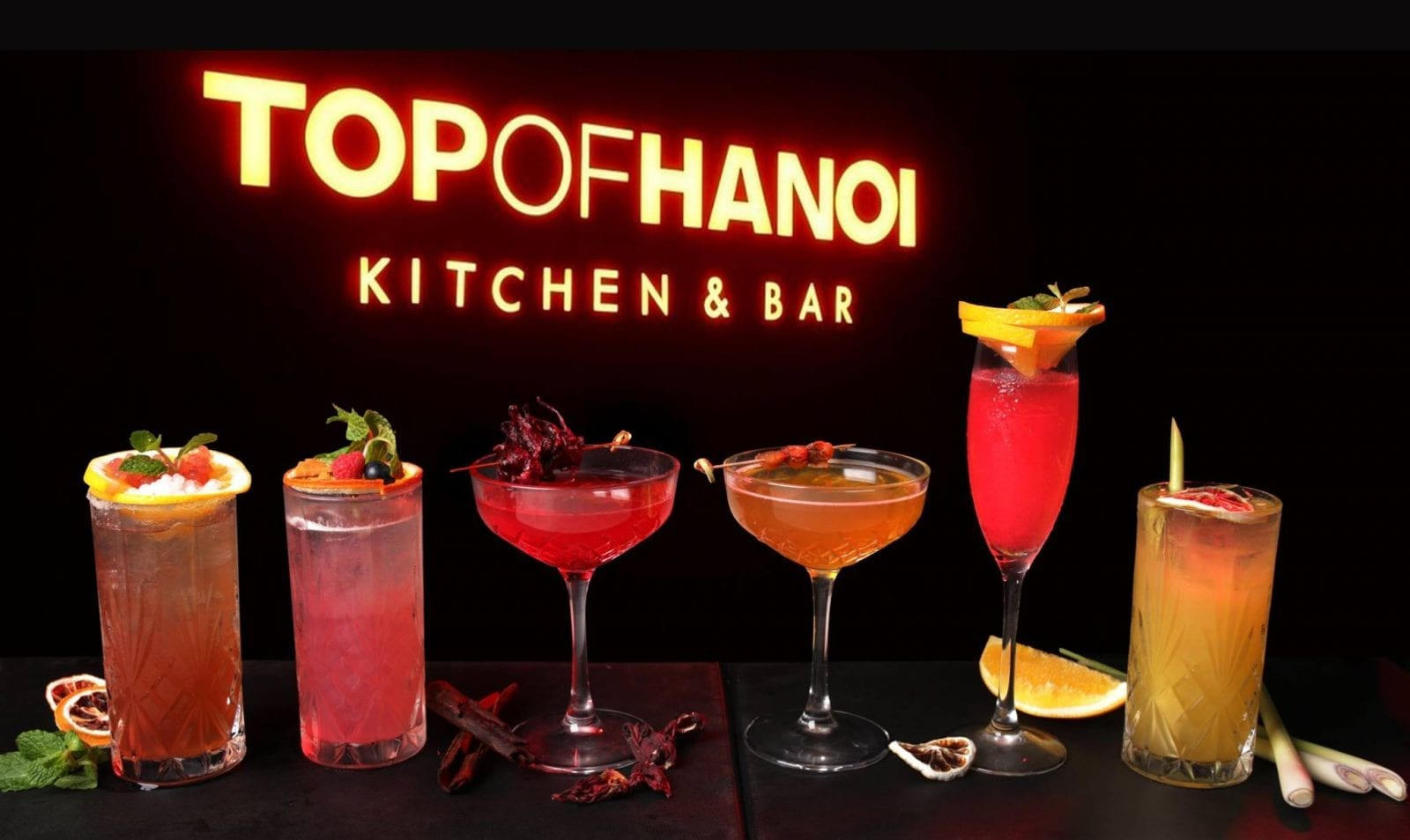 "Image of cocktails in front of the ""Top of Hanoi"" sign at Lotte Center Hanoi in Vietnam"