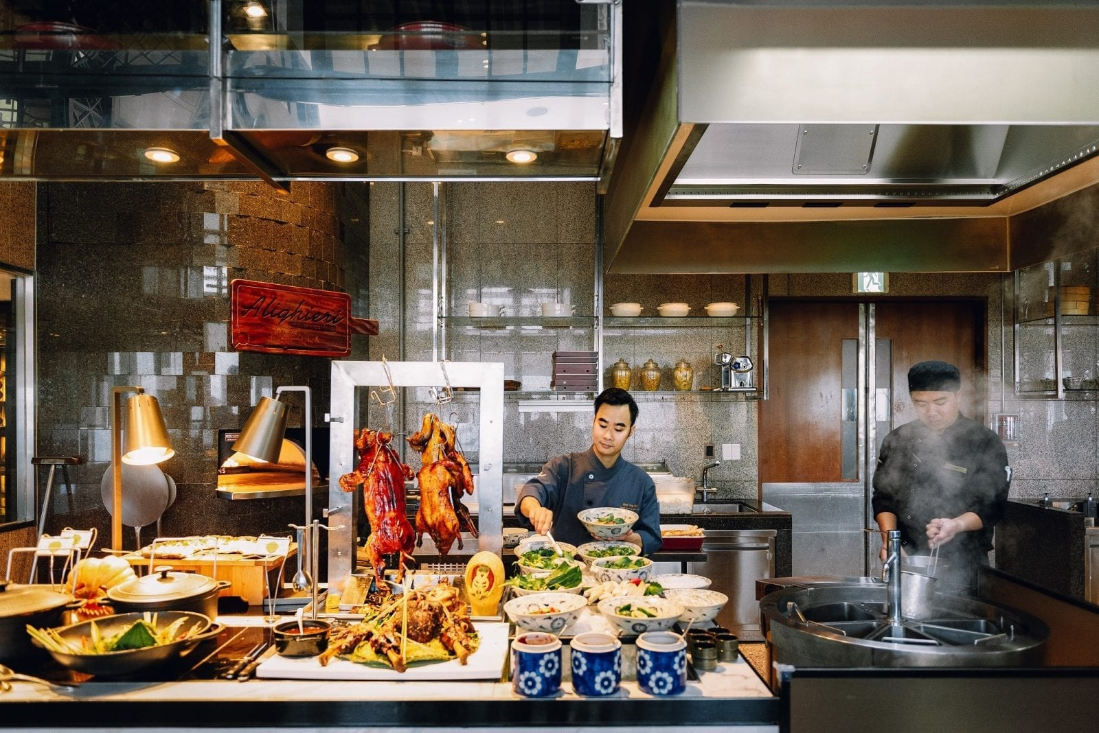 Image of two chefs working at 3spoons at landmark 72 in Hanoi, Vietnam