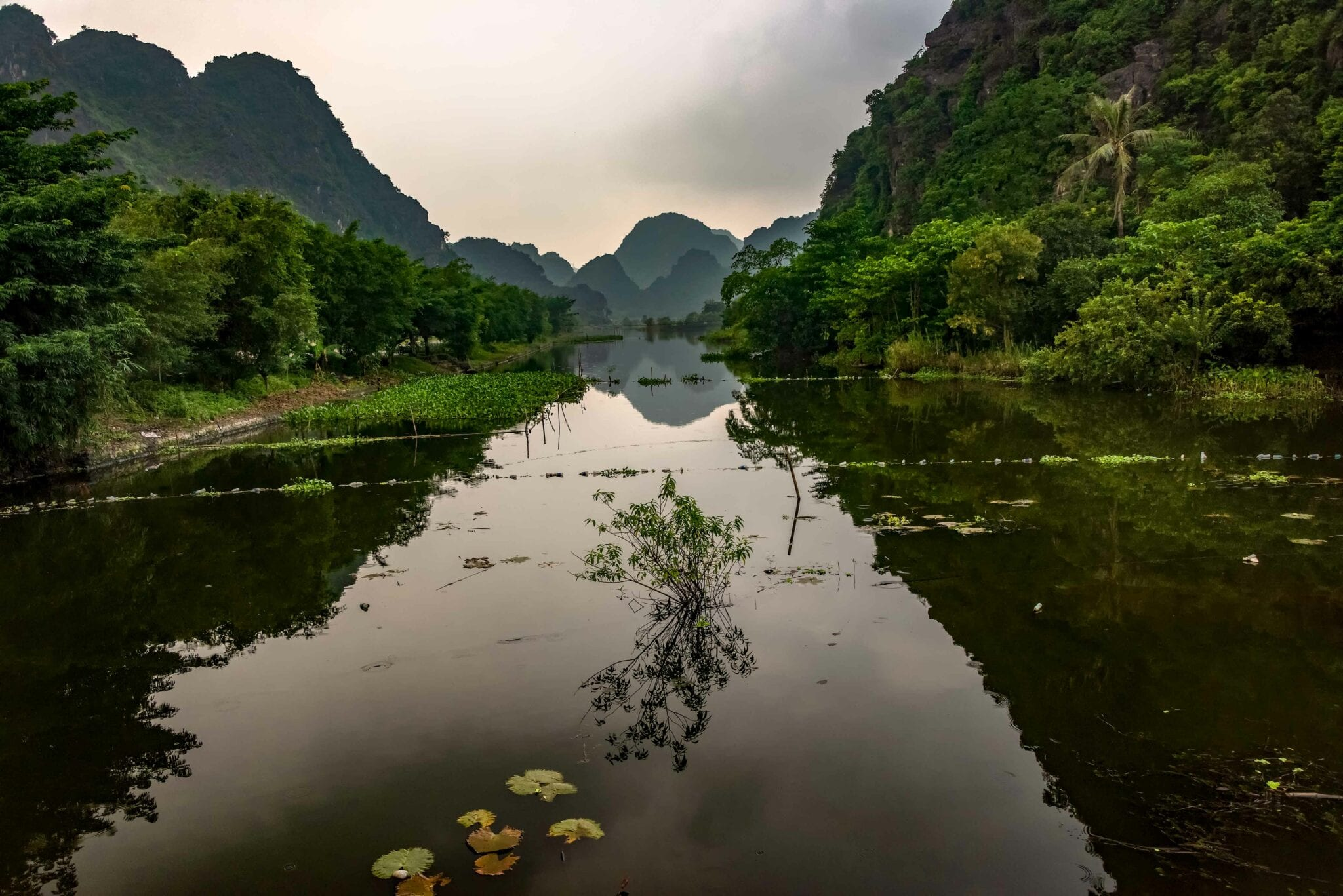 Image looking up the lake in Ba Bê National Park in Vietnam