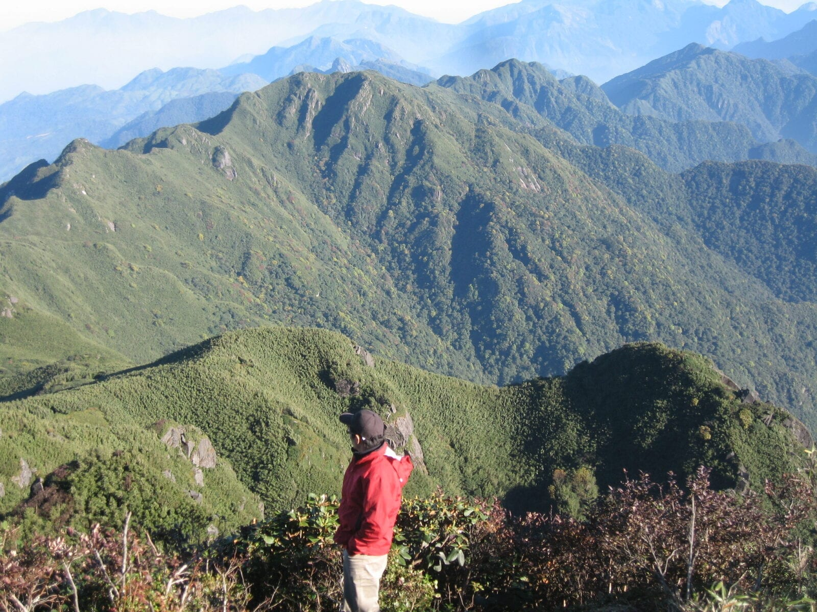 Image of a person looking out at Fansipan Mountain during their hike in Vietnam