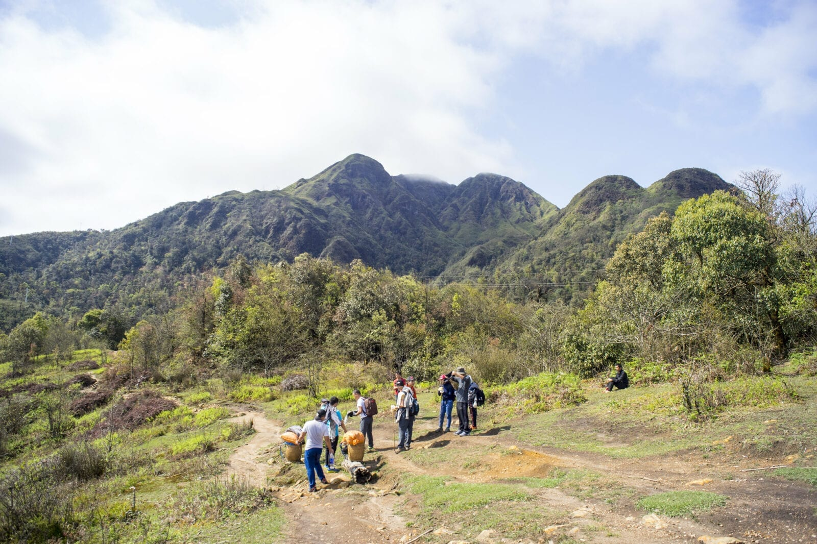 Image of people being guided on a hiking tour of Fansipan Mountain in Vietnam