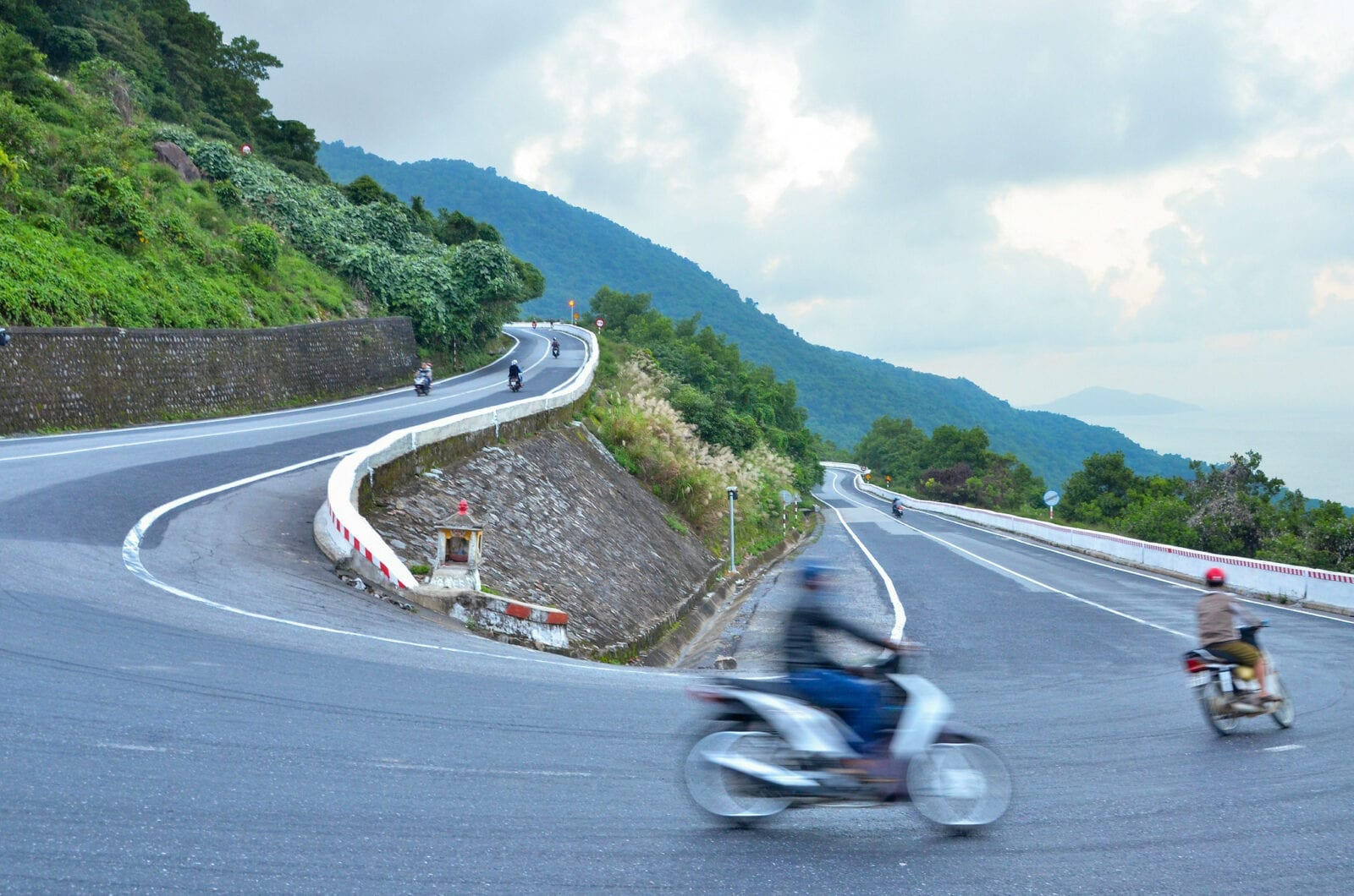 Image of people on a motorcycles on the hai van pass in vietnam