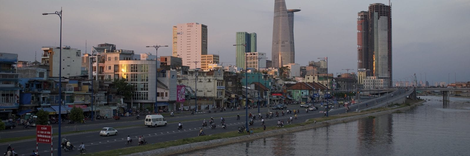 Image of the Ho Chi Minh City skyline by the waterfront with the Saigon One Tower visible