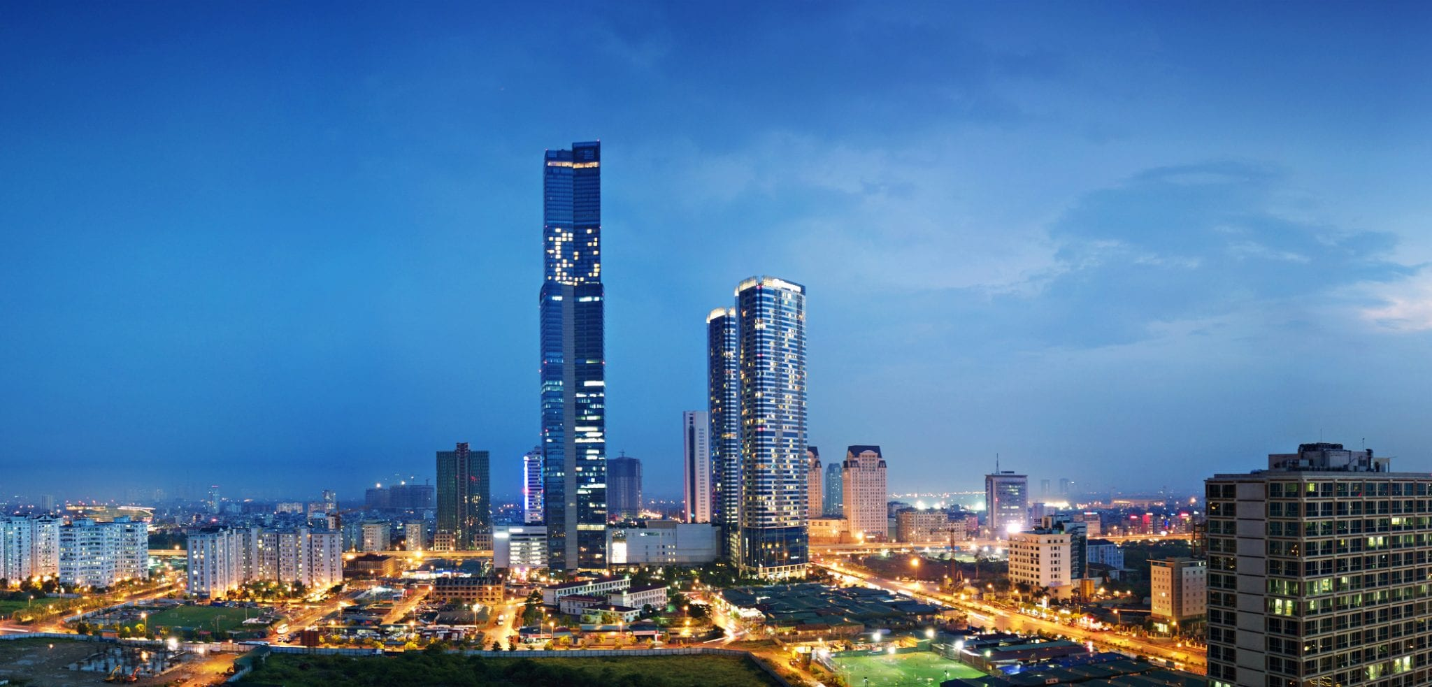 Image of the Keangnam Landmark 72 and residential towers at night in Hanoi, Vietnam