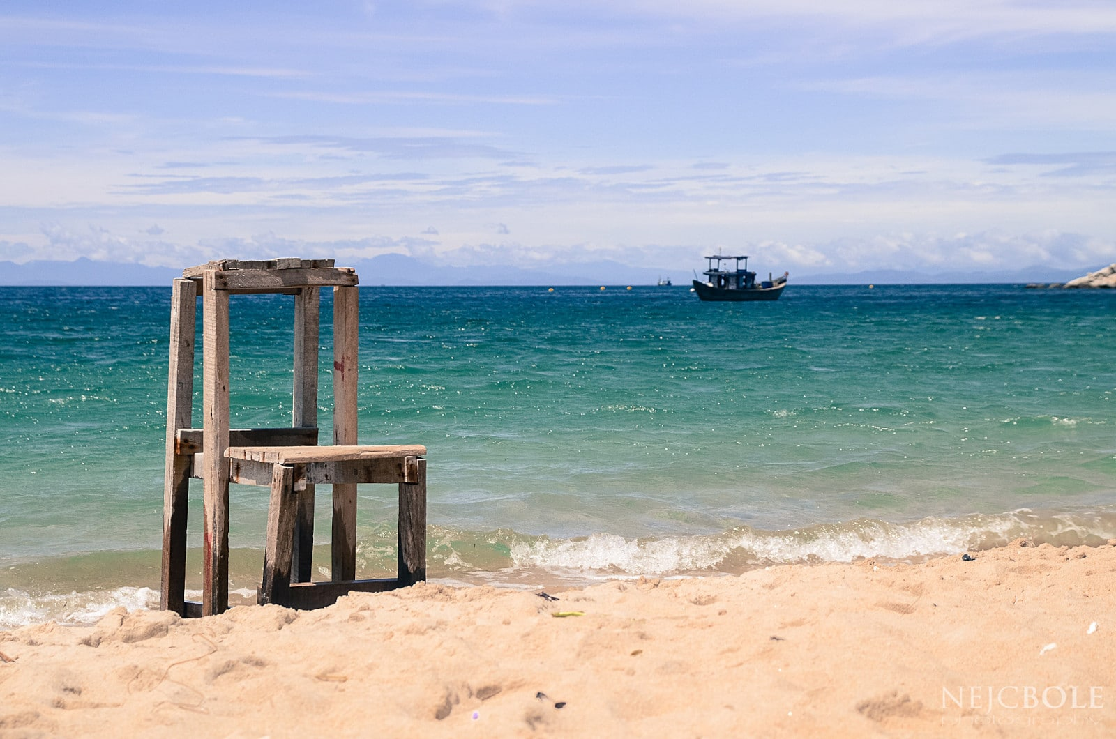 Image of a chair on the shore of one of the cham islands in vietnam