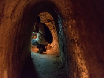 Image of a person in the Cu Chi Tunnels in HCMC, Vietnam