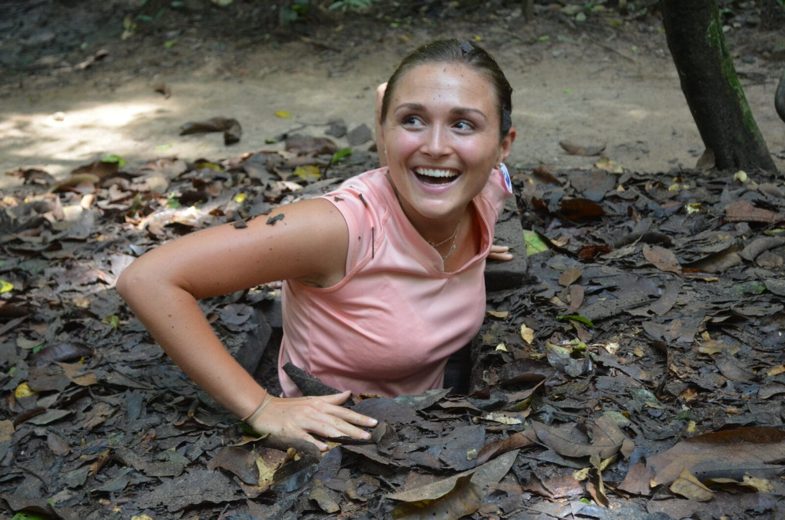Image of a woman coming out of the Cu Chi Tunnels in HCMC, Vietnam