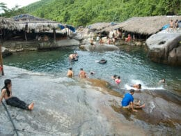 Image of people swimming in the Elephant Springs in Hue, Vietnam