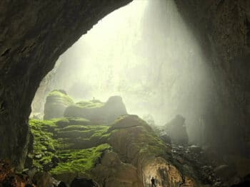 Image of light shinning into Hang Son Doong (cave) in Quang Binh, Vietnam