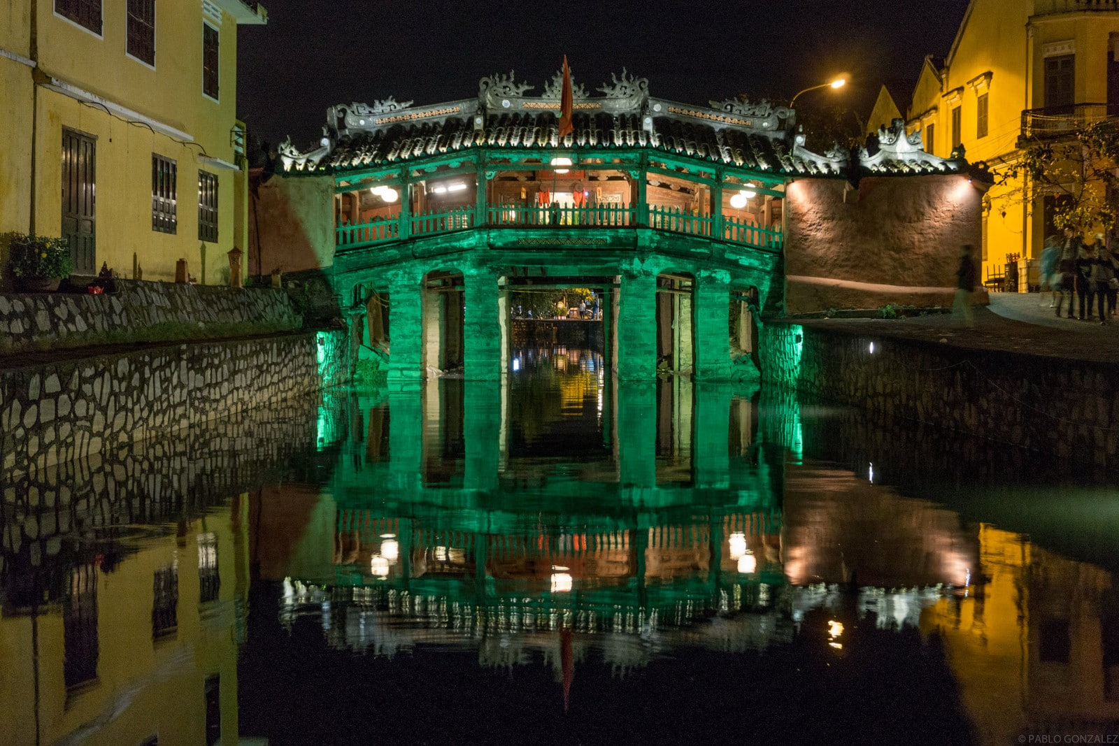Image of the Japanese Covered Bridge in Hoi An, Vietnam illuminated green at night