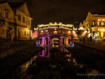 Image of the Japanese Covered Bridge in Hoi An, Vietnam illuminated pink at night