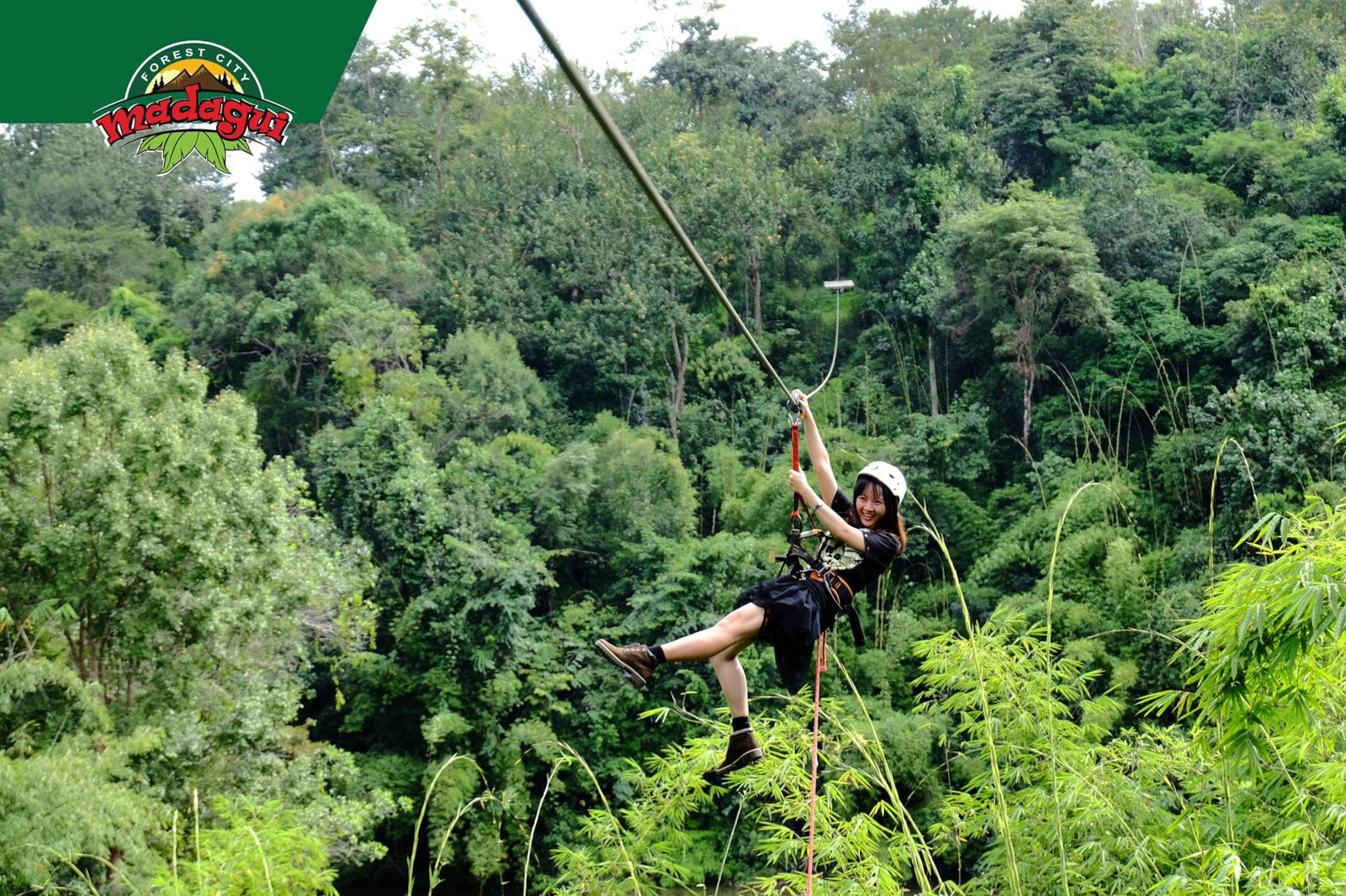 Image of a girl on the Madagui Forest City zipline in Lam Dong Province, Vietnam
