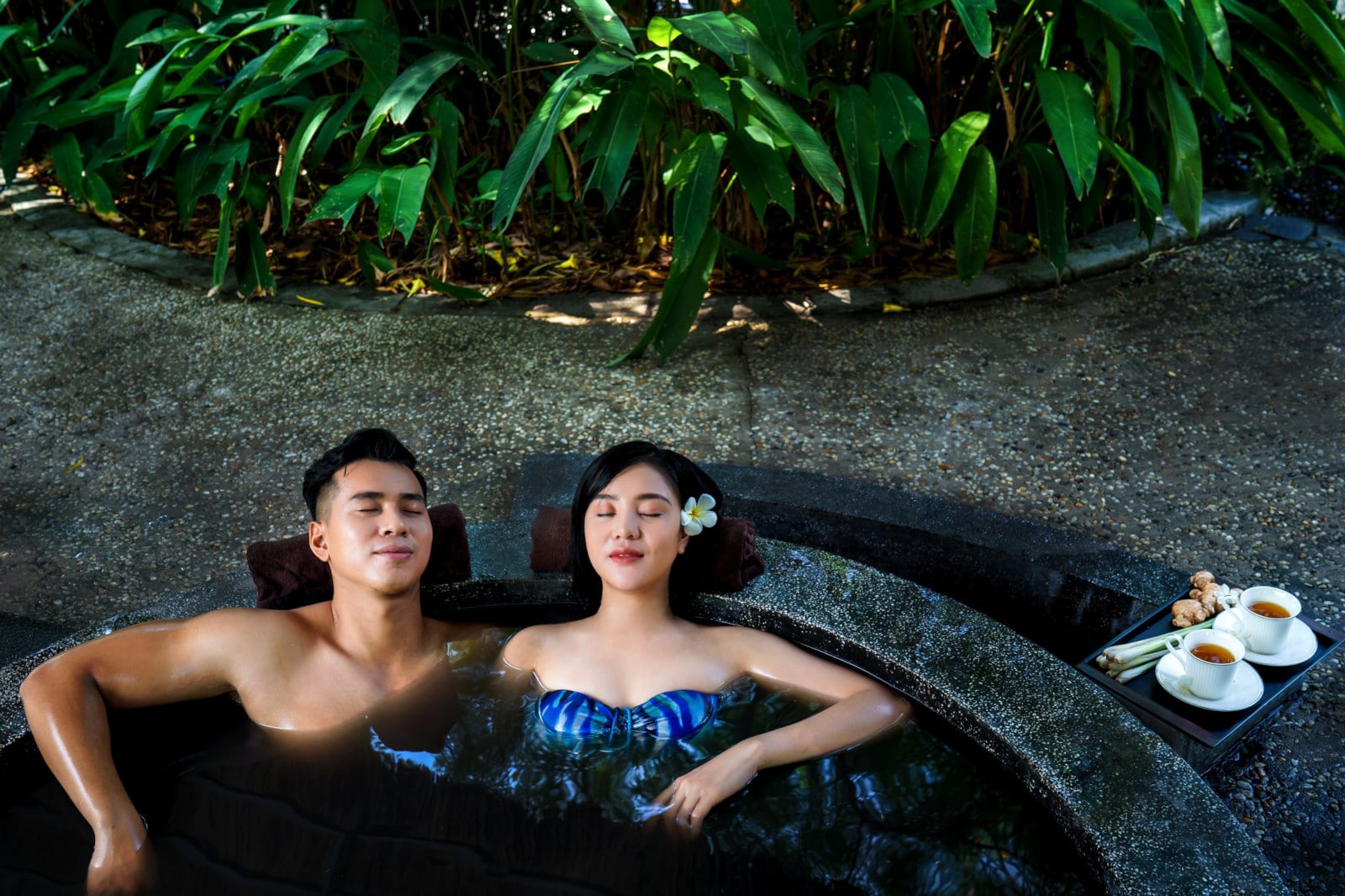 Image of a couple soaking in an outdoor pool at Minera Hot Spring Binh Chau in Vietnam