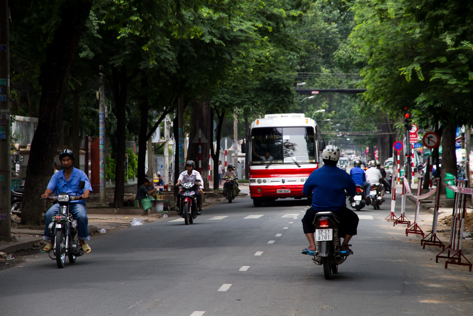 Image of people riding motorbikes on a street in Vietnam