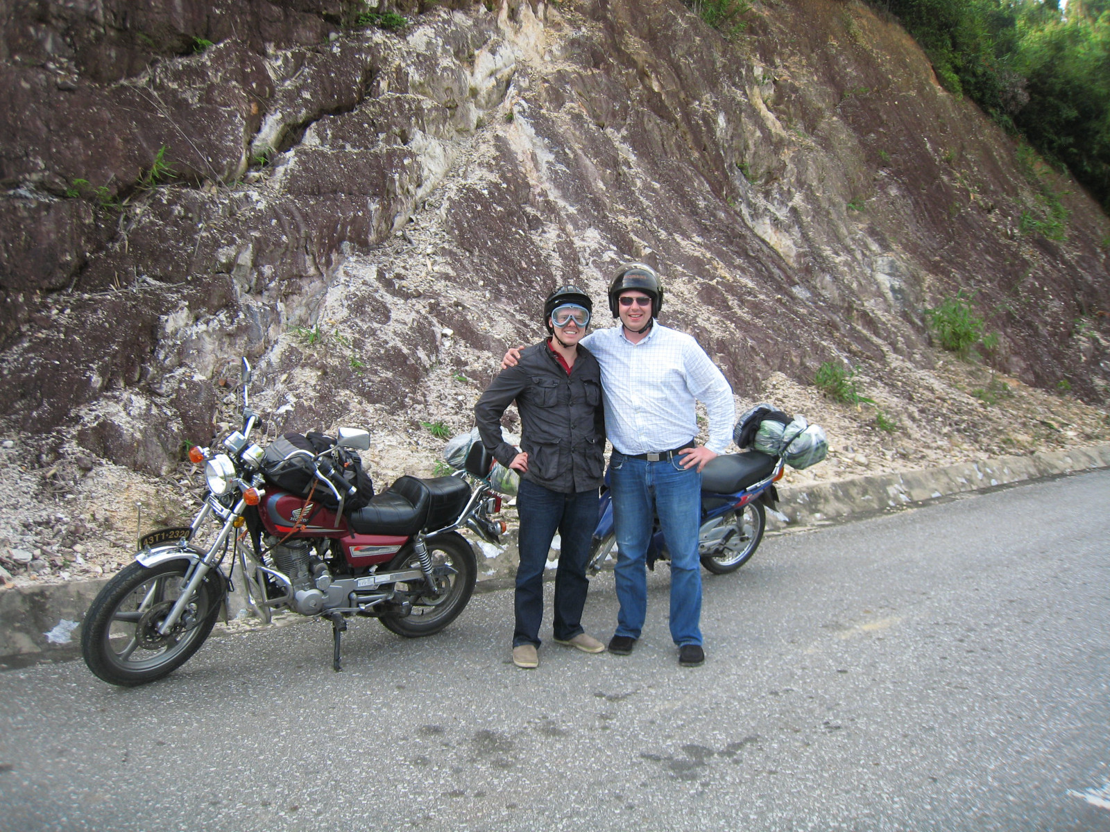 Image of two men posing with their motorbikes in Vietnam
