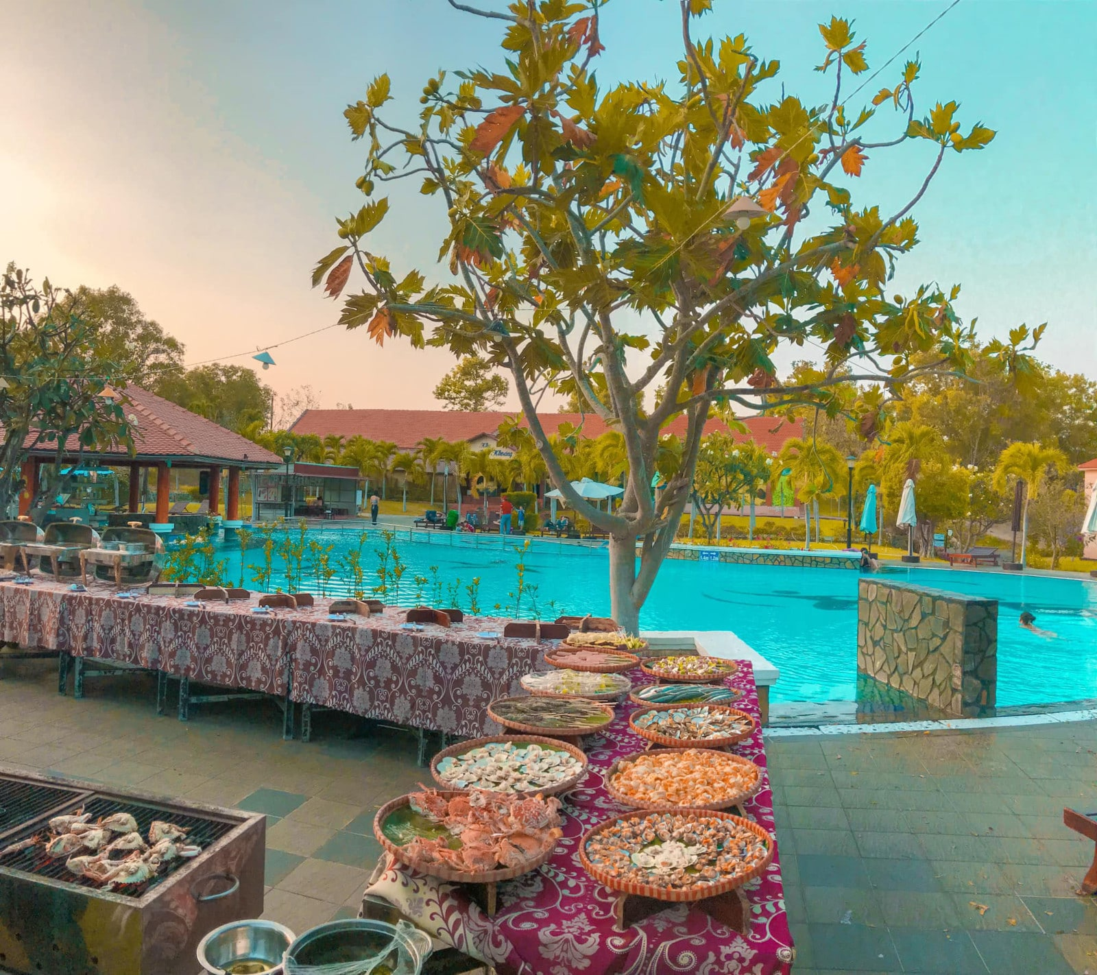 Image of a poolside buffet at the Mui Ne Hot Spring Center in Bin Thuan, Vietnam