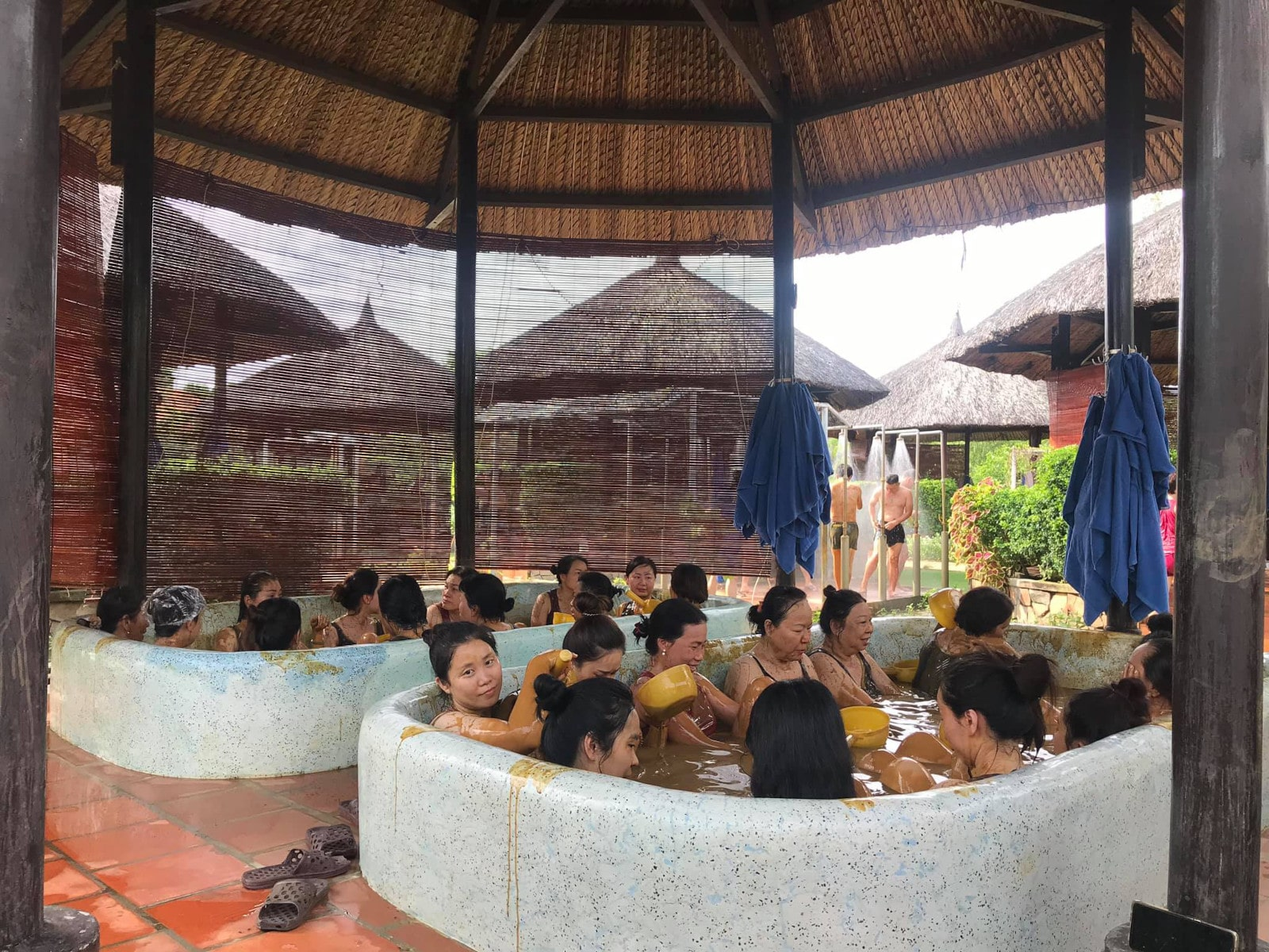 Image of people in the mud baths at Mui Ne Hot Spring Center in Bin Thuan, Vietnam