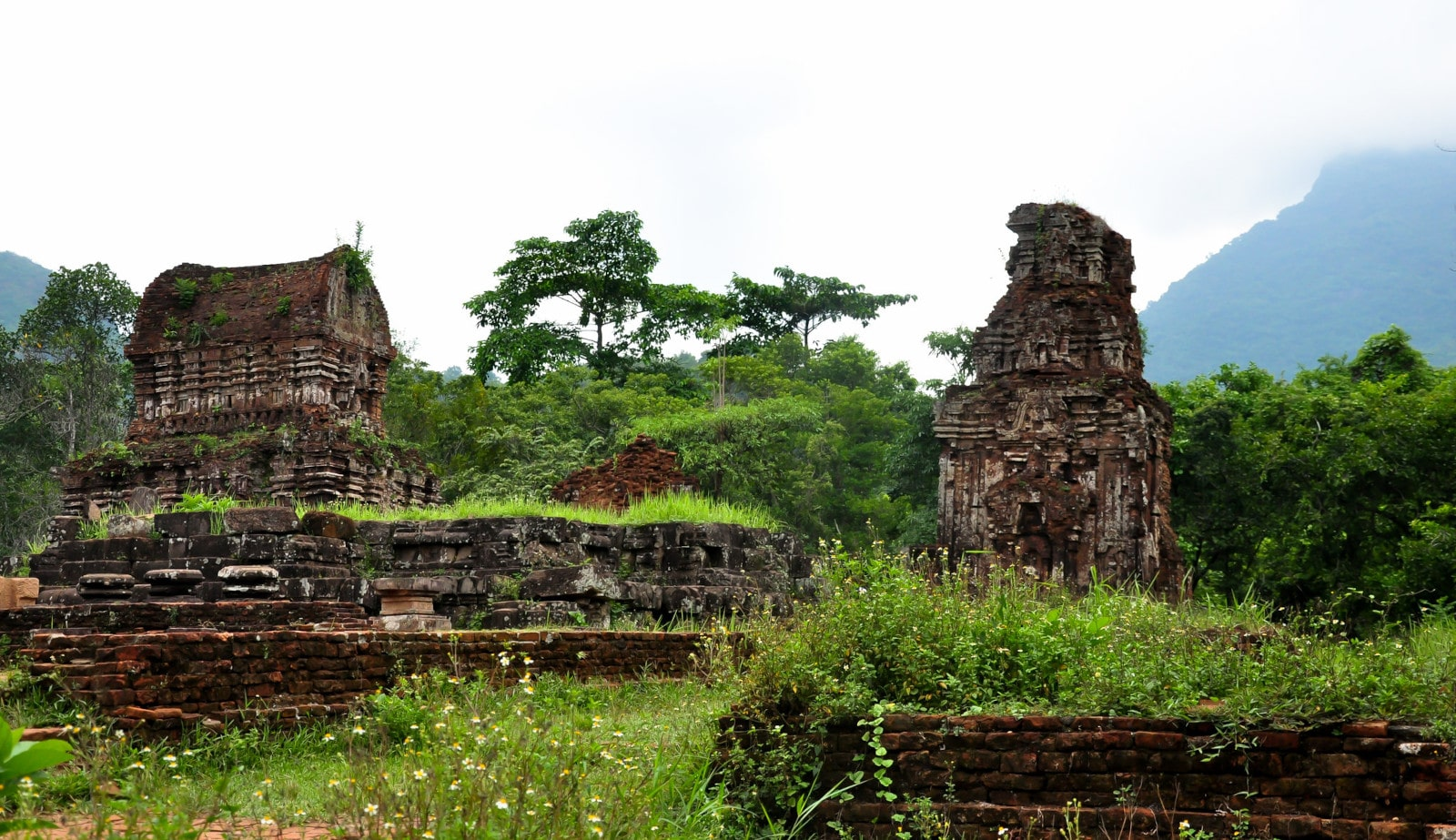 Image of the My Son Sanctuary surrounded by lush green and mountains in Hoi An, Vietnam