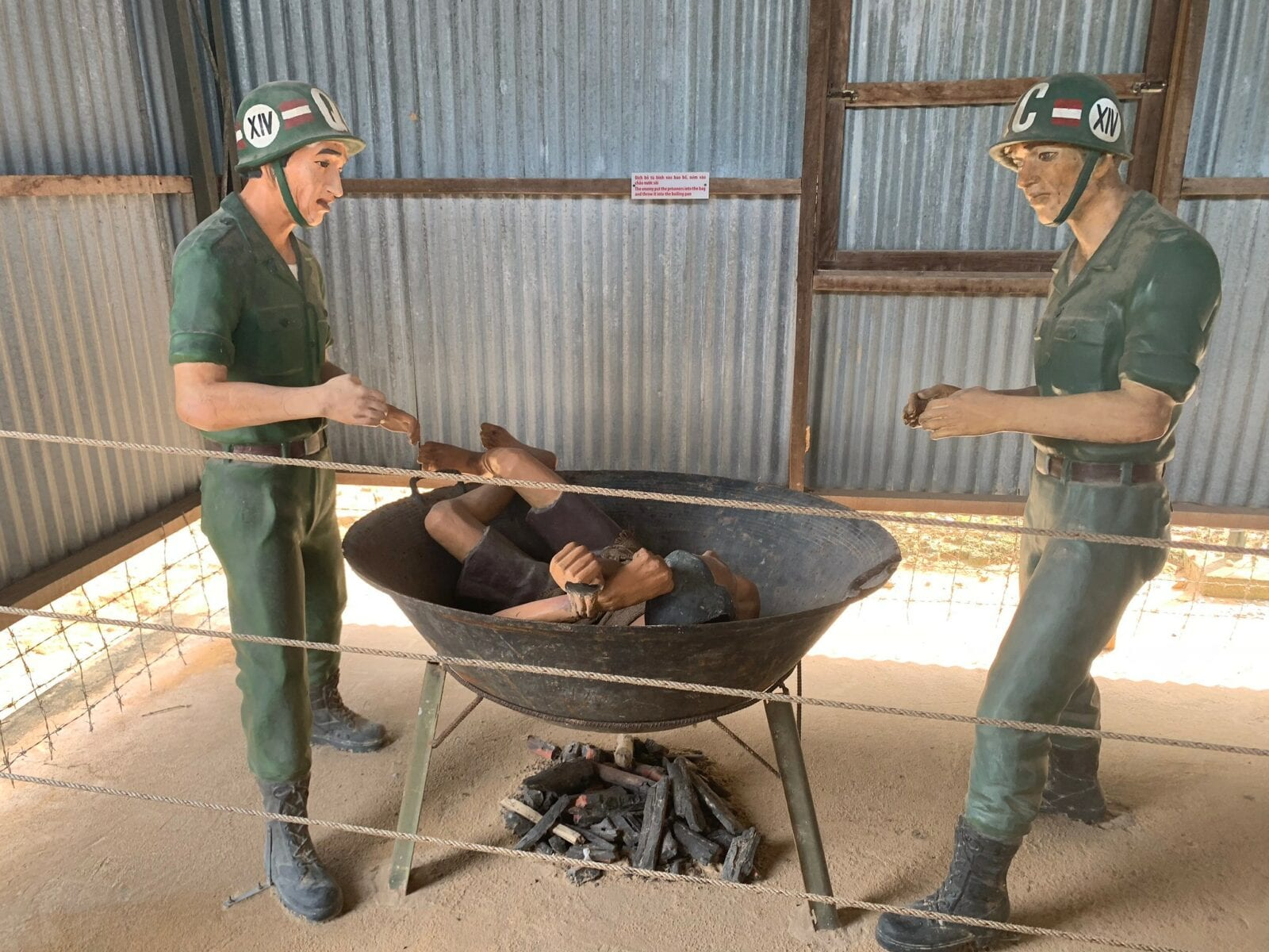 Image of a display showing a POW being tortured by soldiers at the Phu Quoc Prison Museum in Vietnam