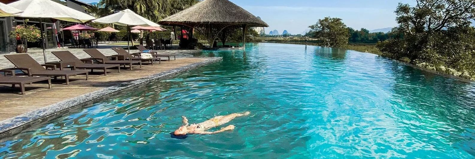 Image of a person swimming in the pool at the Serena Resort in Kim Boi, Hoa Binh Province, Vietnam