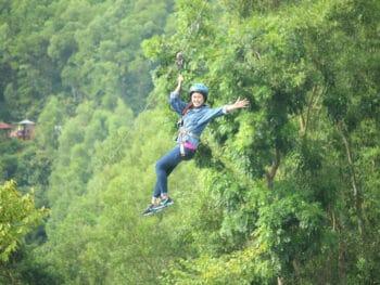 Image of a woman zip-lining at Alba Thanh Tan Hot Spring Resort in Hue, Vietnam