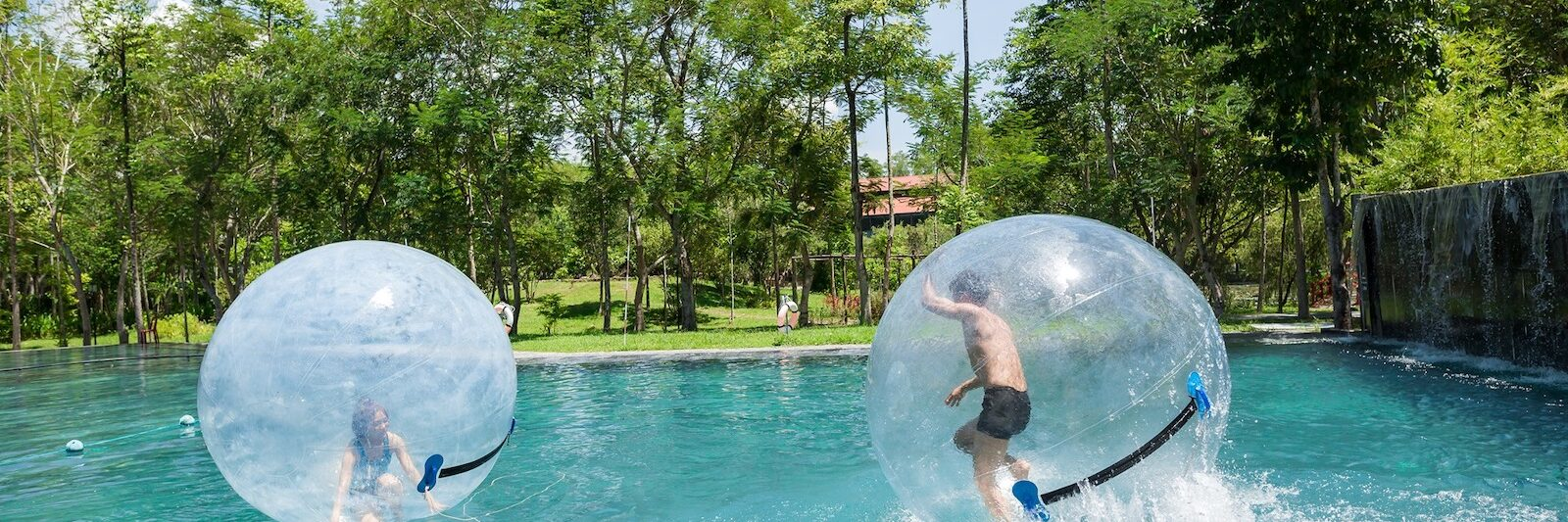 Image of people playing a water game in inflatable balls at Alba Wellness Valley in Hue, Vietnam