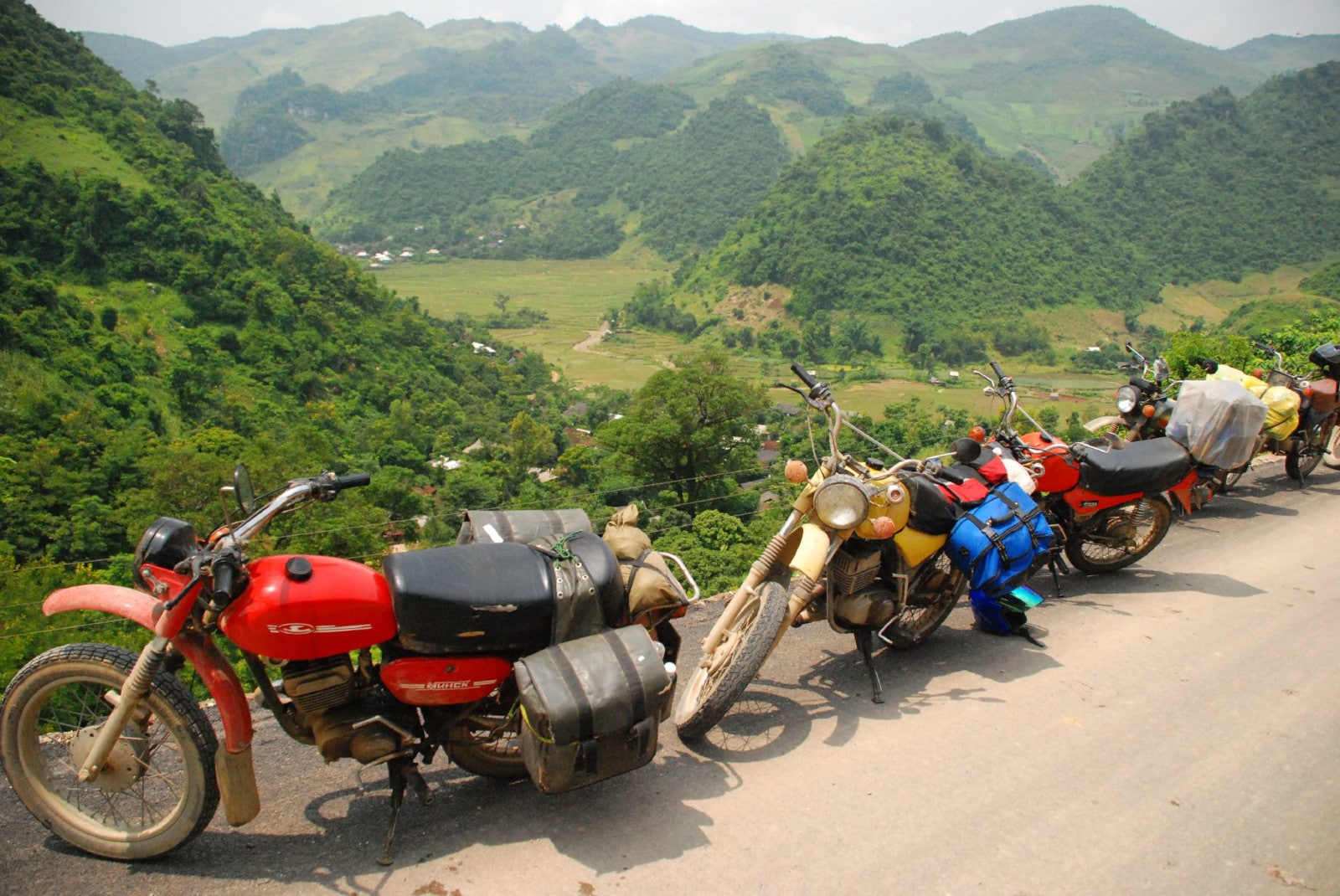 Image of a Minsk motorbike and a scenic Vietnamese view