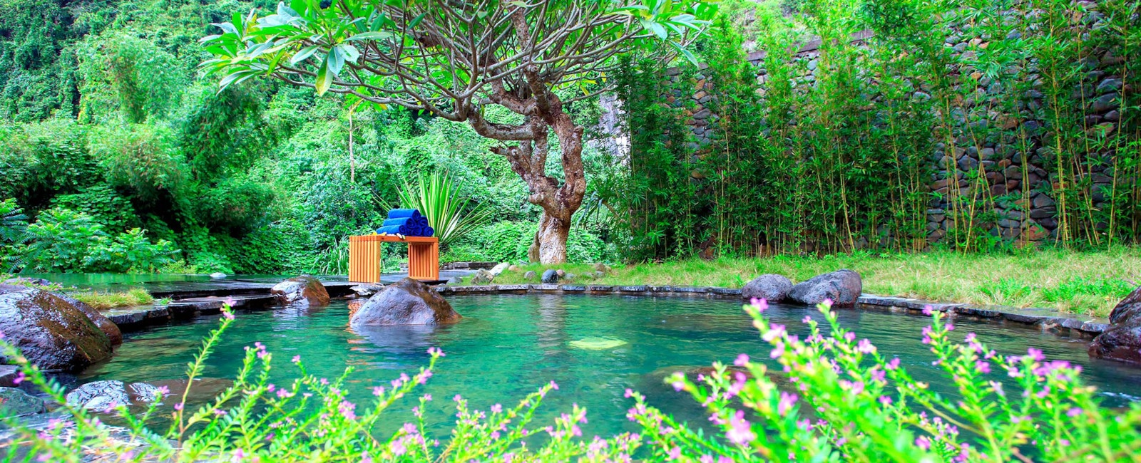 Image of an outdoor hot spring bath at the Serena Resort Kim Boi in Vietnam