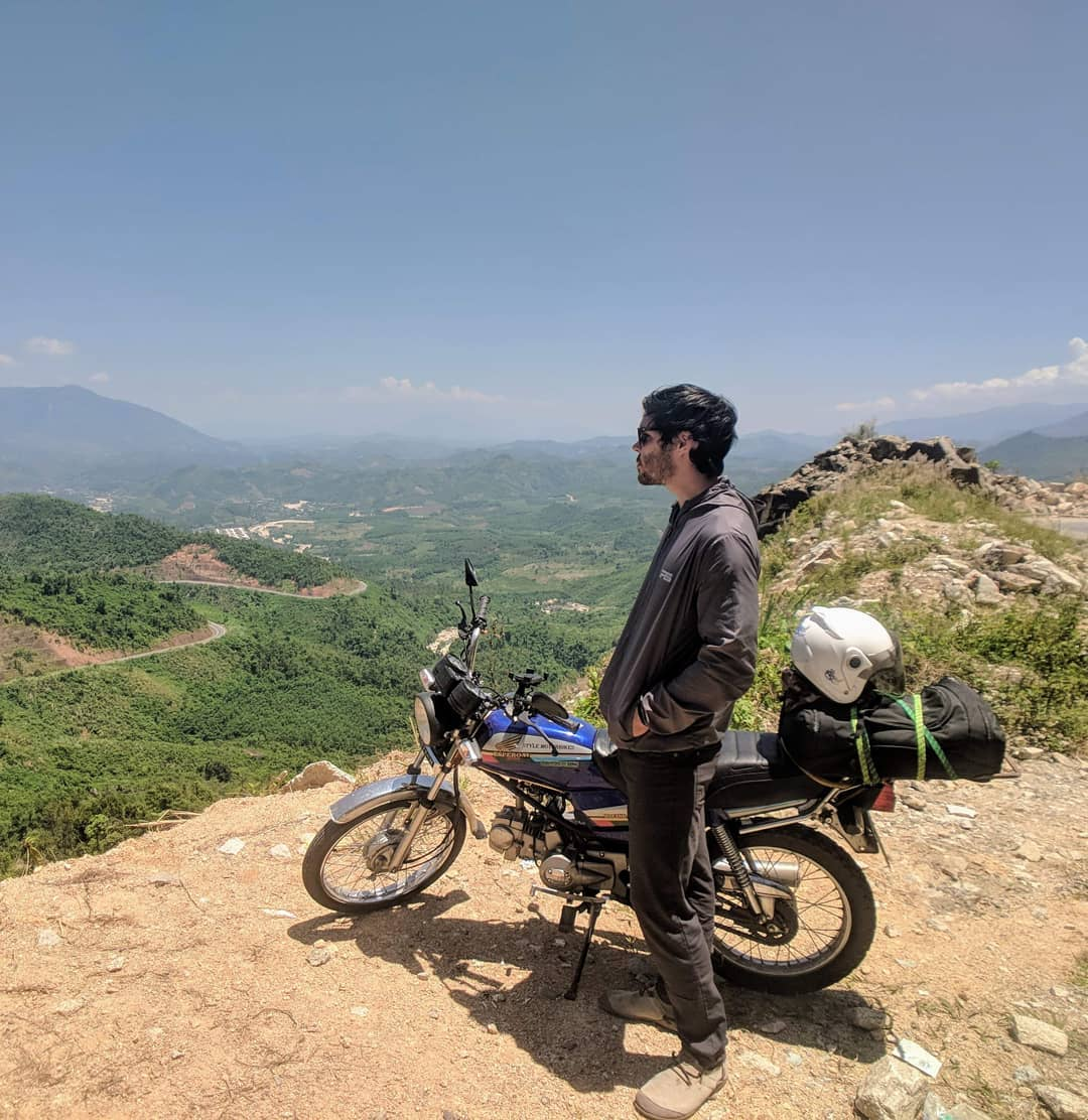 Image of a man looking out over Da Lat with a Styles Motorbike