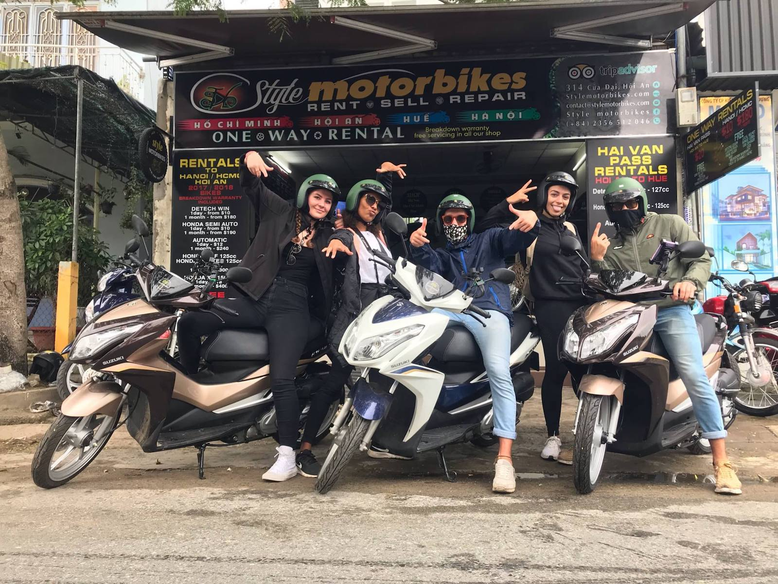 Image of a group of people in front of the Styles Motorbikes store in HCMC, Vietnam