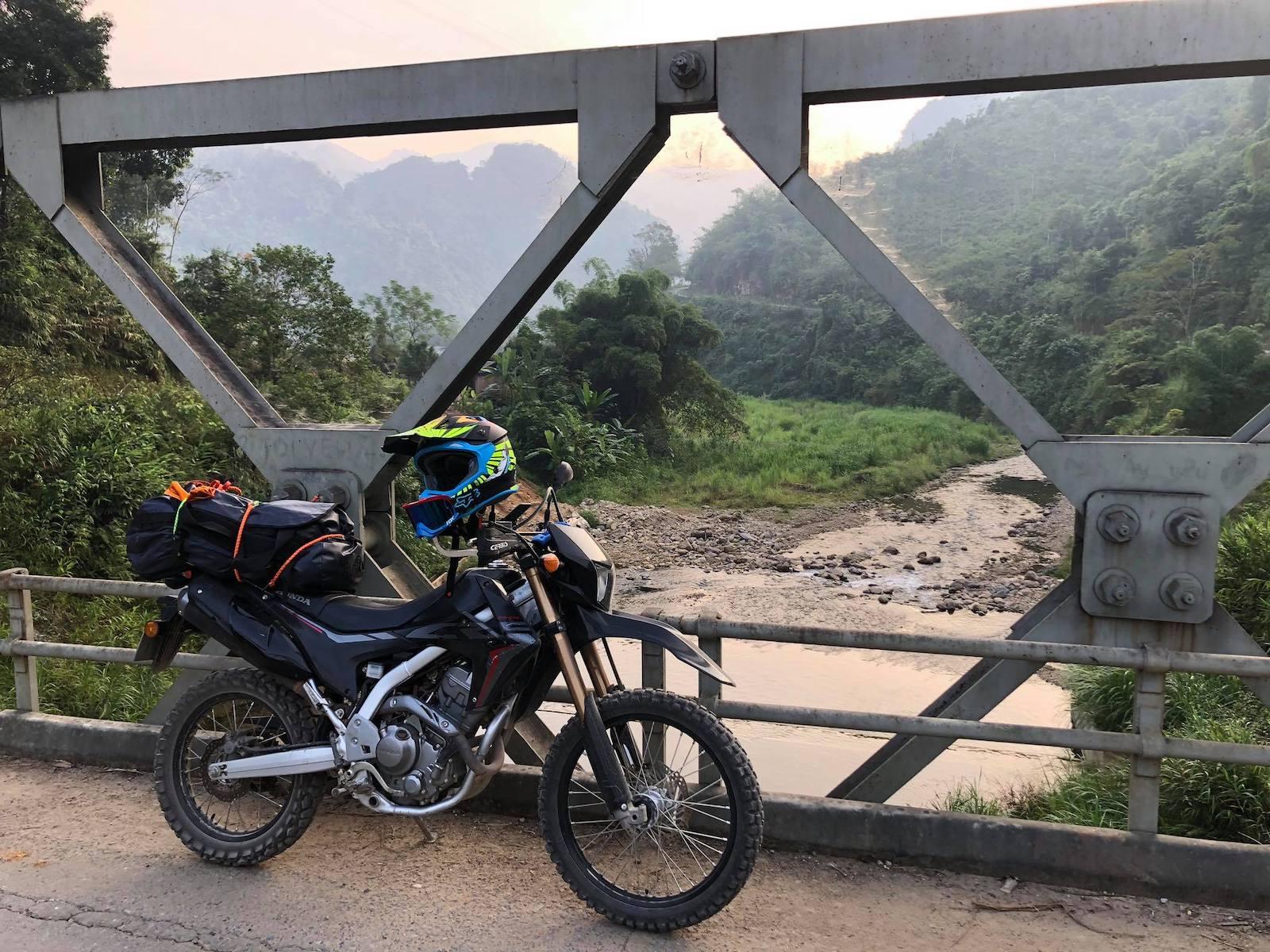 Image of a Tigit Motorbike on a bridge in Vietnam