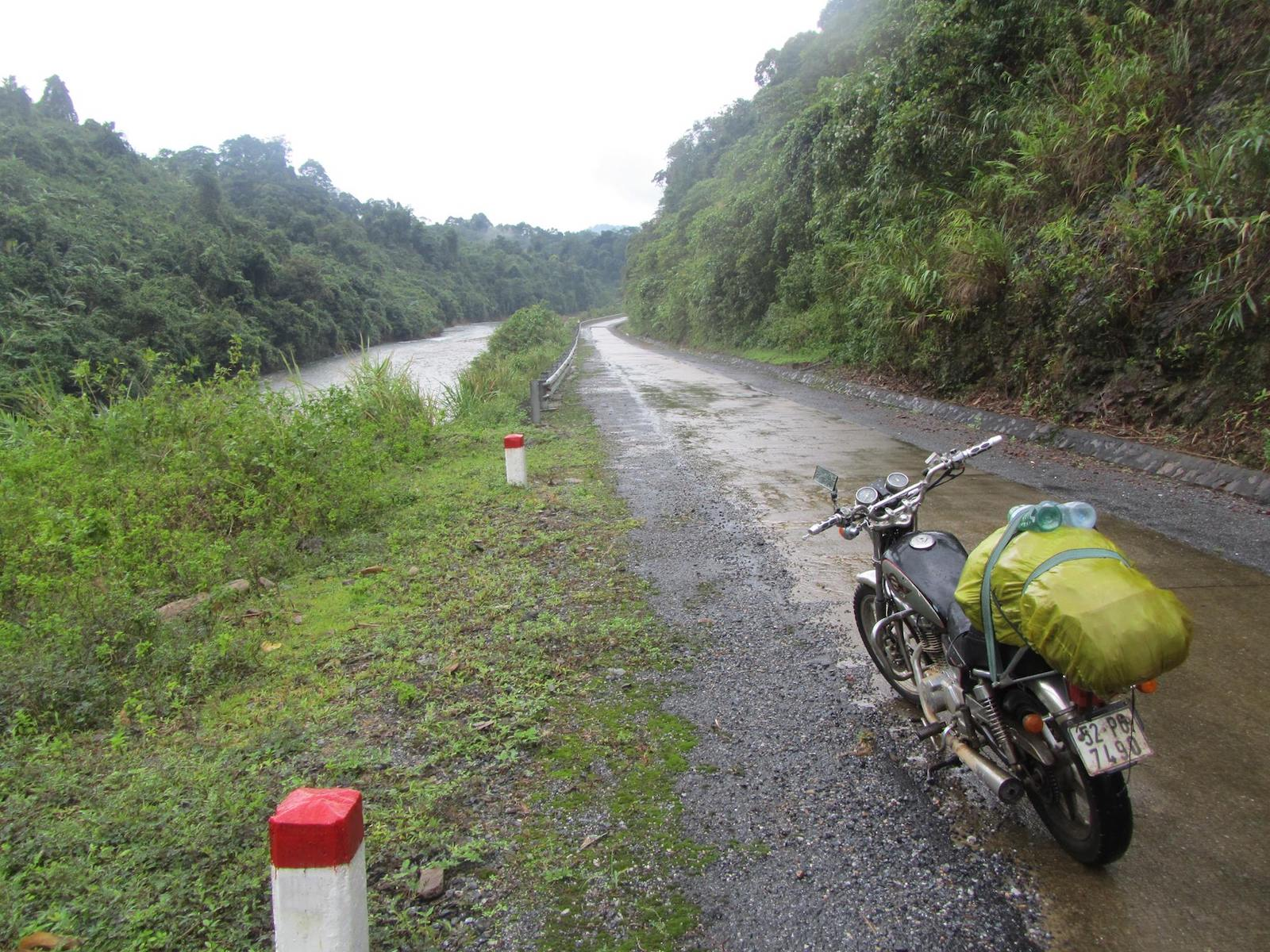 Image of a motorbike on a muddy road in Vietnam