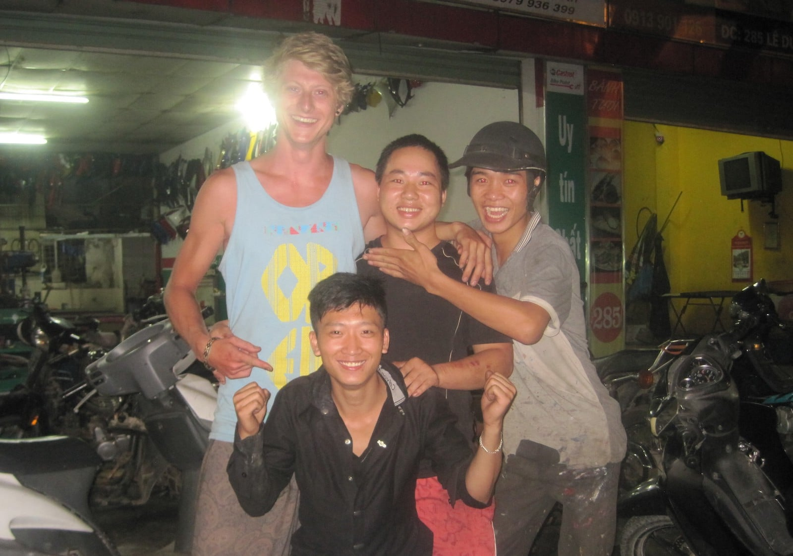Image of Daniel with locals in Vietnam during his motorbike trip