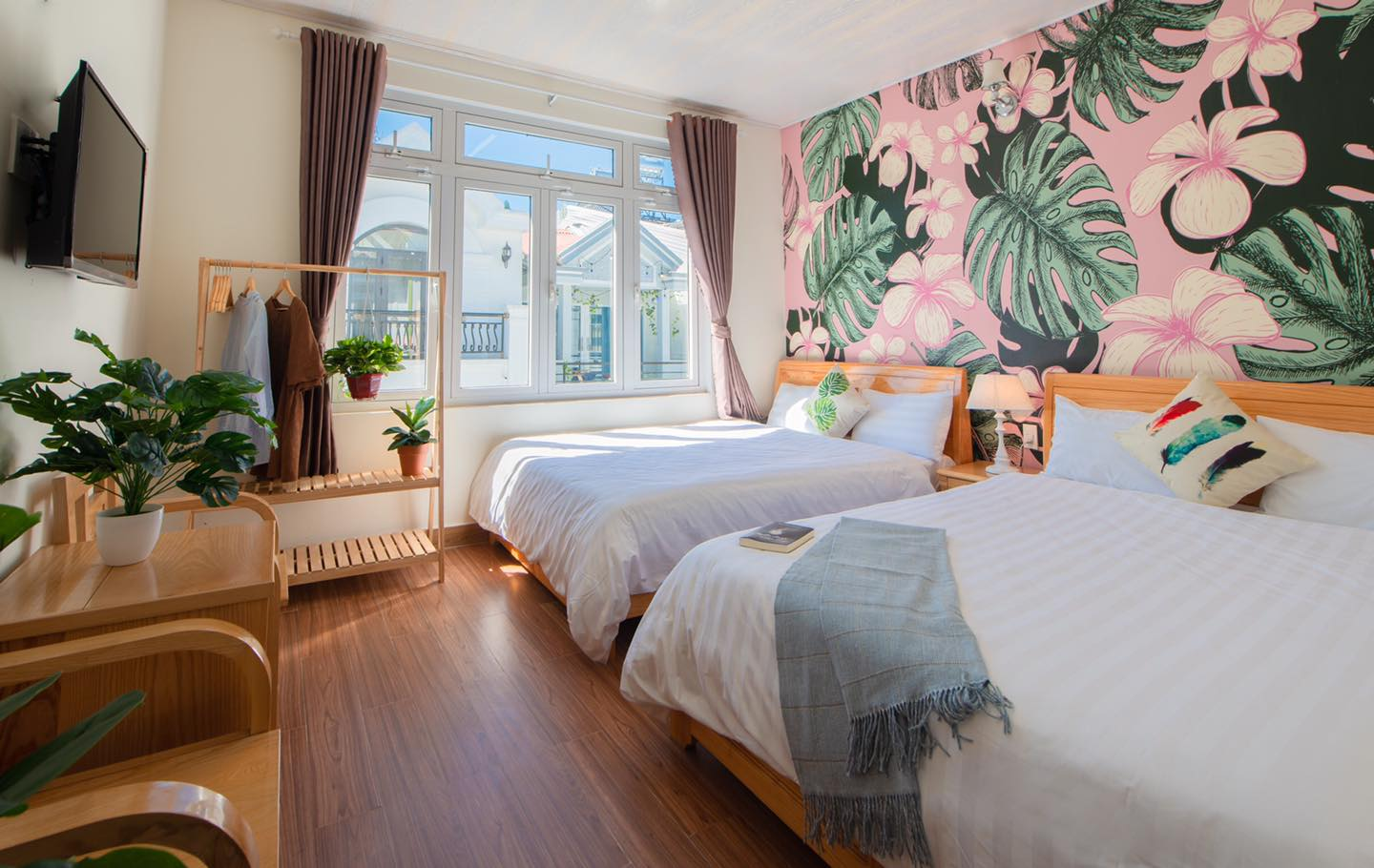 Image of a pink palm themed room at Moc Thach Hostel in Da Lat, Vietnam