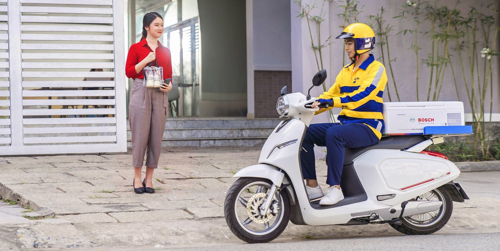 Image of a be motorbike picking up a delivery