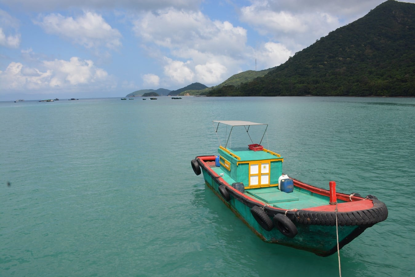Image of a boat on the water at Port of Ben Dam, Con Dao Island in Vietnam