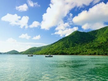 Image of a lush green landscape and ocean on Con Dao