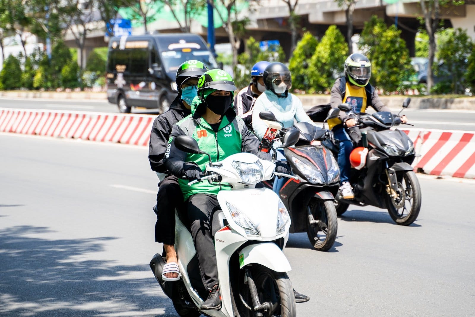 Image of a person on a Gojek motorbike in Vietnam