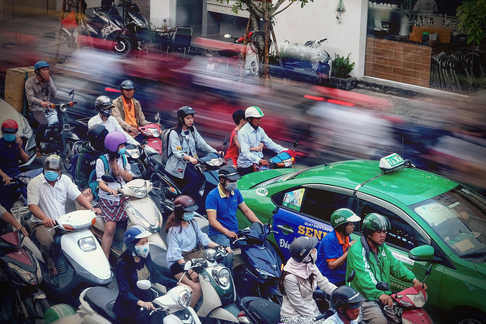 Image of a GrabTaxi in Saigon traffic